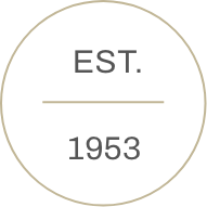 Circle icon with text that reads EST. 1953